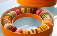 "Pâtissier Pierre Hermé macarons  (standards: chocolate, coffee and pistachio) ""Signature"" collection consists of flavors as extraordinary as olive oil and vanilla, rose, caramel à la fleur de sel (the caramel cream is made with semi-sweet butter) and passion fruit with milk chocolate."
