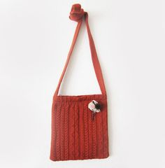 dark orange knitted bag with a long strap by sofiapaseka on Etsy, $48.00