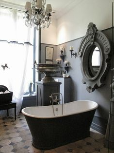 very alternative dark victorian bathroom. well suited to a large home.