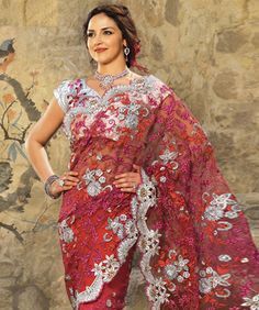 Drape yourself with some of the most ethnic yet contemporary styled sarees. The collection marks gorgeous designs and a touch of grace and tradition. Adding shine to your ethnic wardrobe, these various styles are crafted with great detailing and amazing quality. BRAND: Rati FashionsCATEGORY: Saree with Unstitched BlouseARTICLECOLOURMATERIALLENGTHSareeBrick RedNet5.40 metersBlouseSilverDupion Silk0.90 metersWe would always want to send you what we showcase but there might be a slight…