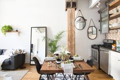 Hope and Reed never had a proper dining area prior to this apartment, so when Becky was able to squeeze in this dining table with mismatched chairs, they immediately started dreaming up future dinner parties. The chairs are both reminiscent of Eames and Wagner classics.
