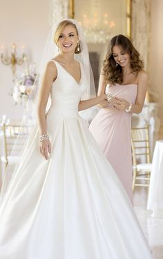 For brides looking for A-Line wedding dresses, this timeless and elegant wedding gown in Organza and French Mikado from Stella York features clean lines and lovely pleating.