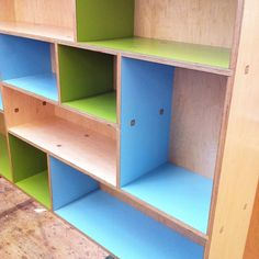 A beautiful maple plywood bookcase and its colors. Avocado and space laminate. Made by Kerf Design kerfdesign.com