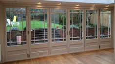 Solid Wood Bifold doors by Enfield Windows of Enfield, North London. Made to measure double glazed wooden bi-folding doors Wooden Bifold Doors, Wood Doors, Bifold Glass Doors, Kitchen Bifold Doors, White Bifold Doors, Porch Doors, Windows And Doors, Entry Doors, Open Plan Kitchen Living Room