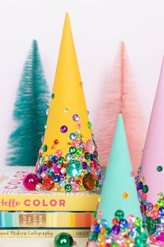 DIY Colorful Rhinestone Tree Decorations // Decorate mache cones with colorful paint and rhinestones to make sparkly tree decorations! These easy DIY Christmas trees make great mantel decor or shelf accessories for the holiday season! Retro Christmas Decorations, Diy Christmas Tree, Merry Little Christmas, Winter Christmas, Vintage Christmas, Christmas Ornaments, Tree Decorations, Whimsical Christmas, Decoration Table