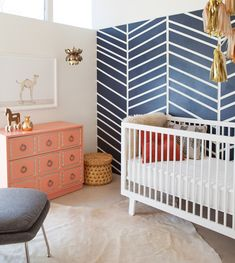 The Animal Print Shop Nursery Project. Sweet baby boy's nursery design with Navy blue chevron accent wall and Confetti System Tassel Garland over Oeuf Sparrow Crib. The Animal Shop Camel Print paired with coral Dorothy D Kids Room Design, Nursery Design, Baby Design, Animal Print Shop, Animal Prints, Art Prints, Sophisticated Nursery, Herringbone Wall, Herringbone Pattern