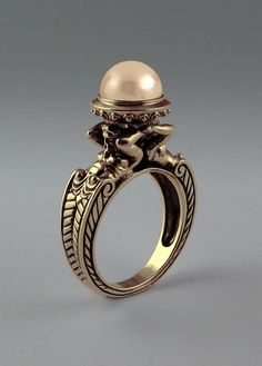 Ring designed by Sergey Zhiboedov - it's inspired by the antique Greek architecture and true classic style, and includes 14k gold figures of the Atlant (male) and the Caryatid (female) giants supporting a 9mm freshwater pearl