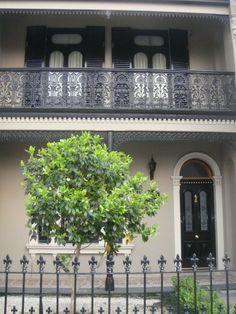 - Terrace House with Dune Facade, Dark Grey Fretwork & Shutters, Black Front Door with Cream Surround, Dark Grey Iron Fence & Cream Window Surround. Exterior Color Schemes, House Color Schemes, Exterior Paint Colors, Exterior House Colors, Colour Schemes, Exterior Design, Colour Palettes, Terrace House Exterior, Victorian Terrace House