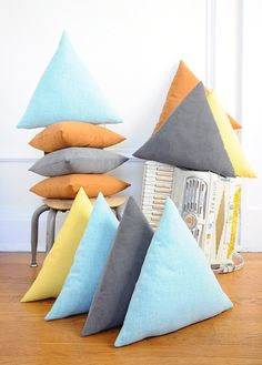 Triangle Pillow - GREY Corduroy on Etsy, $44.00 - orange and blue would look so cute on my gray couch!