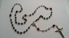 A young man recently lost his mother.  His girlfriend ordered a rosary for him with his mother's name on it.