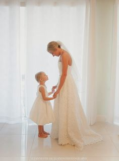 White Beautiful A-Line Lace sleeveless gown a very special moment before the wedding At Key Largo Lighthouse Beach Wedding Venue in the Florida Keys