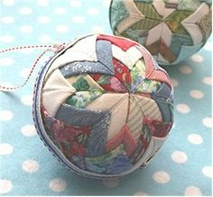 Multicolored quilted ball, nice homey look, lots of possibilities, too. Do opposite quarters the same, etc.