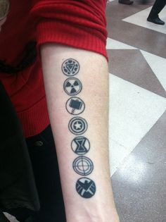 The geek ink includes (from the top down) Iron Man, Hulk, Thor, Captain America, Black Widow, Hawkeye, and the S.H.I.E.L.D. logo.
