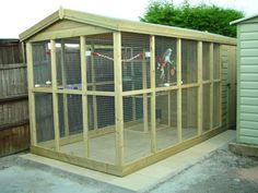 An aviary is a shed or cage like construction designed as a living space for wild or domesticated fowl. Given that birds are used to flying free in their natural habitat it is important to recreate as best we can this kind of environm Pet Bird Cage, Bird Cages, Parrot Cages, Aviary For Sale, Bird House Kits, Hen House, Bird Aviary, Parrot Toys, How To Attract Birds