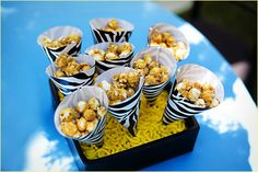 Put caramel popcorn  or kettle corn into paper cones and set them up in the red-and-white striped boxes from Ikea (we already have some).