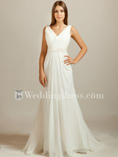 Casual wedding dress features in Chiffon. Surplice bodice is created with a V-neckline and open back. Beaded waistband is enhanced at the natural waistline. Corset Closure completes the style. This dress is fully lined. #beachweddingdress