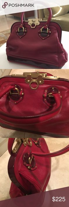 Red Zac Posen aurora handbag. Rich leather. This stunning bag features brass hardware and patent leather finishes. Beautiful suede interior with three pockets. Gold grommets on bottom protect from wear and tear. Great condition. Zac Posen Bags Satchels