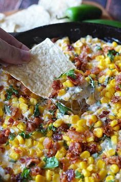 Crockpot Spicy Bacon Corn Dip  2 pkgs. frozen corn 1-8 oz. brick cream cheese 1-1/2 c. cheddar cheese 1 can green chiles Jalepeno to taste 1 c. chopped green onion  Throw all together in the crockpot and cook on low for 4 hours.  Halfway through cooking time, stir it all together.
