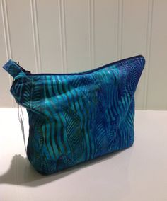 Purple and Aqua Feathers makeup bag by PhoebeMade on Etsy, $15.00