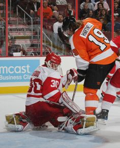 The Flyers Scott Hartnell takes shot on the Red Wings Chris Osgood