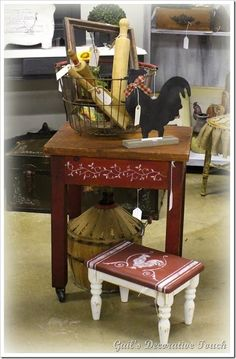 cute red table on wheels stenciled and foot stool