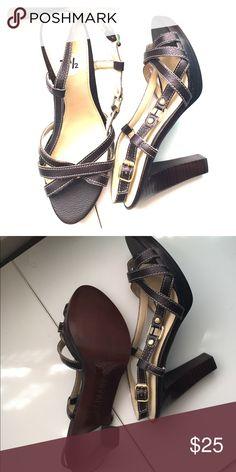 Ralph Lauren brown High Heel Sandals Dark brown Leather strappy heels in size 7.5. They have never been worn. Lauren Ralph Lauren Shoes Heels