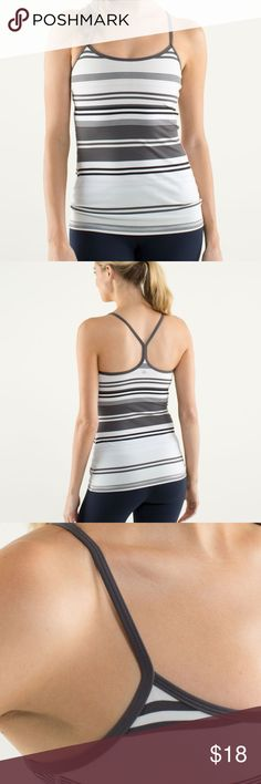 Lululemon Power Y Tank Top Shelf Bra Groovy Stripe Made of moisture-wicking luon light, this fitted tank with a built-in shelf bra gives us just the right amount of support. The lightweight fabric and thin, racerback straps allow for open, unrestricted movement in the shoulders and the long length intentionally covers our asana.   Key features -thin straps and racerback cut allow you to twist with ease -the built-in shelf bra is lined with moisture-wicking COOLMAX®   Small unnoticeable stain…