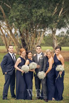 Beautiful bride Elizabeth chose the Ingrid Dress in Navy by Pia Gladys Perey for her gorgeous bridesmaids.#whiterunway #realrunway #realwedding
