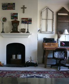 folksy eclectic display in living room from Apartment Therapy