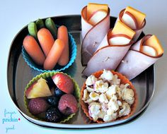 Here's what's inside: Ham & Cheese Apple Wraps (thick cut ham slices (cut in half), thin slice of apple and a thin slice of cheddar cheese)= 5 carbs Angie's Boomchickapop Frosted Sugar Cookie Kettle Corn Popcorn= 7 carbs Chobani Yogurt Tube (not pictured)= 7 carbs Fresh Veggies (baby carrots & snap peas)= 4 carbs Fresh Fruit (strawberries, blackberries, blueberries, raspberries, & pineapple)= 7 carbs Lunch Total= 30 carbohydrates