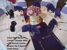 Swiss Park Banquet Center, Whittier CA. Package C with white half-length tablecloths, white chair covers, bright purple organza bows and purple pintuck runner. Centerpieces of lilac roses inside pearl filled vases on a round mirror and votives provided by A Special Event Decor, Whittier CA. White Chair Covers, Lilac Roses, Bright Purple, Center Table, Round Mirrors, Pin Tucks, Tablecloths, Banquet, Event Decor