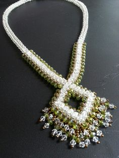 CRAW diamond pendant with crystal, rondell and seed bead embellishments. (Ginas Gem Creations)