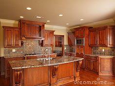 Luxury Home dark wood kitchen cabinets and center island