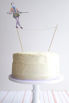 {Ideas for a Circus-themed party from @Andrea / FICTILIS / FICTILIS Fellman} How fantastic is this tightrope-walking birthday cake?! #kidsparty #socialcircus