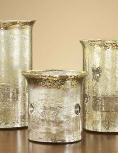 The gold-crackle finish gives them antiqued appeal, while the reflective finish enhances the candle's glow.