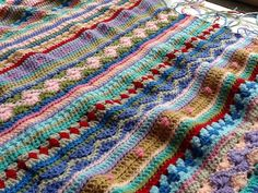 For my throw sized blanket I used 11 skeins of Stylecraft Special DK (in shades Parchment, Meadow, Fondant, Sherbet, Aspen, Apricot, Candyfloss, Lavender, Aster, Lipstick, and Pale Rose for the border). It was a close call though, so if you plan on making something larger than a throw I'd definitely get two balls of each color (but you could still just get 1 for the border color). You can use any colors or indeed any kind of yarn that you would like!