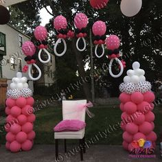 This baby shower balloon arch is designed with everything that a mom-to-be needs...baby bottles and lots of baby pacifier!