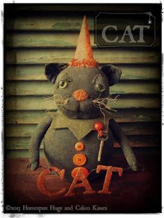 A Primitive Black Halloween Cat Doll by Homespun Hugs and Calico Kisses Primitives