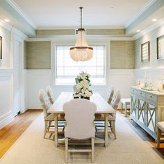 Dining Room Wainscoting. Dining Room Wainscoting Wall. Dining Room Wainscoting Wall Ideas. This dining room with wainscoting also features a white beaded chandelier Currey and Co Hedy Chandelier. #DiningRoomWainscoting #DiningRoomWainscotingWall Waterleaf Interiors.