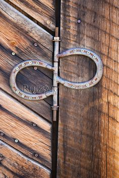 Western barn door with homemade hinge made out from old horseshoes.