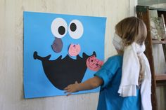 put the cookie in cookie monsters mouth. I feel like a Sesame Street Party will someday be in our future.