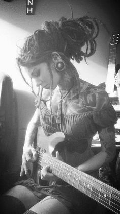 Modern day Siren. Dreads, tats, gauges, and music. What more could you ask from a women.