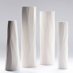 Slip cast bone china sculptural vessels, produced in limited editions by Award Winning Ceramicist Keith Varney in his Somerset studio.The faceted flowing forms, created through intuitive mark making, are animated by light and shade. These translucent and pure white vessels, the result of the interplay of material and process, posses a natural organic quality and the diamond polished silky surfaces are invitingly tactile.The straight sided vessels are available in three heigh...
