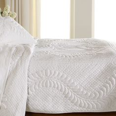 Crisp, white cotton poplin takes a dramatic turn in this striking, decorative quilt. The trapunto quilting technique in which extra batting is added to create raised areas lends depth and visual inter