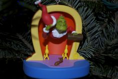 "my newest ornament - it plays my favorite christmas song, ""you're a mean one, Mr. Grinch""!"