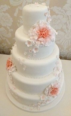 5 tier wedding cake with large carnations and blossoms