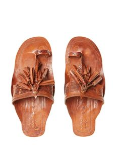 <p>Indian-inspired brown leather toe-ring sandals finished with playful fringe and tassel detailing. </p>