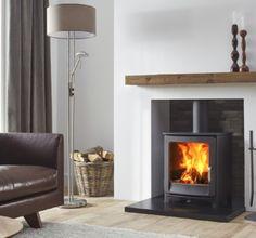 De #Dik #Geurts #Keld #Low is voorzien van een gietijzeren deur met mooie ronde vormen. De Dik Geurts Keld Low is uitermate geschikt voor plaatsing onder een bestaande #schouw. Met de soepele luchtschuif kan het vuur optimaal worden geregeld. Standaard wordt de Dik Geurts Keld Low geleverd in de kleur donker antraciet. Wood Burner Fireplace, Slate Fireplace, Home Fireplace, Mid Century Modern Living Room, Living Room Grey, Home And Living, Living Room Decor, Woodland Living Room, Cosy Lounge