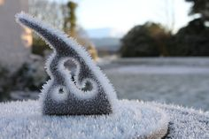 Frozen moment.  (Sundial in Barcaldine Castle gardens Scotland)
