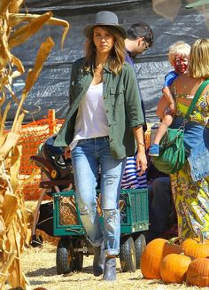 Pin for Later: 96 Ways to Wear Denim, Courtesy of Jessica Alba  Cruising Mr. Bones Pumpkin Patch in ripped boyfriend jeans, The Perfect Shirt by Current/Elliott, and gray ankle boots.